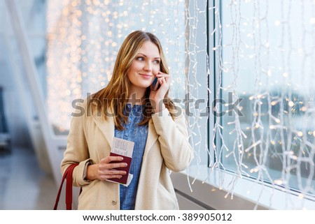 Beautiful business woman in international aiport. Ready to fly. Paris airport, France - stock photo