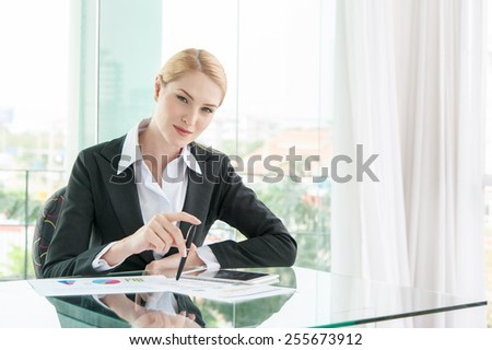 beautiful business woman in office - stock photo