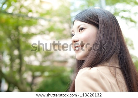 Beautiful business woman in the town. Portrait of asian.