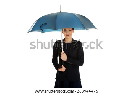Beautiful business woman is holding blue umbrella.
