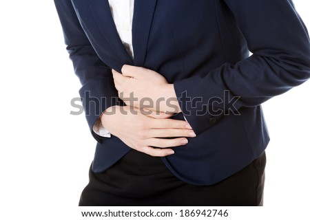 Beautiful business woman is touching her stomach. Isolated on white. - stock photo