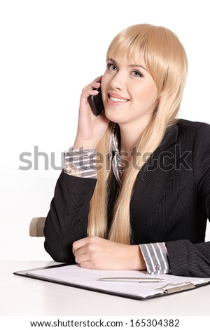 Beautiful business woman making phone call sitting at table