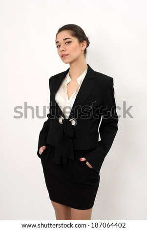 beautiful business woman on a white background looking at the camera