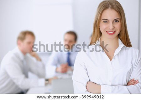 Beautiful business woman on the background of business people during meeting