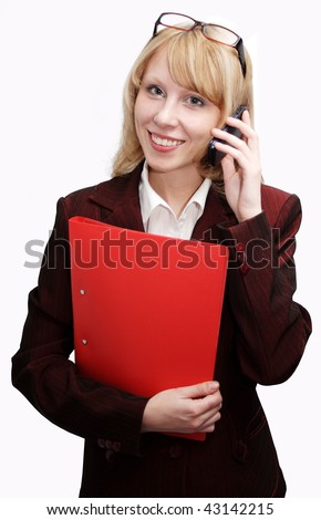 Beautiful business woman on the phone on a white background.