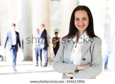 Beautiful business woman portrait and people blur on the background. Modern business life concept