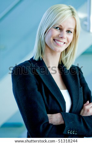 Beautiful business woman portrait smiling at the office - stock photo