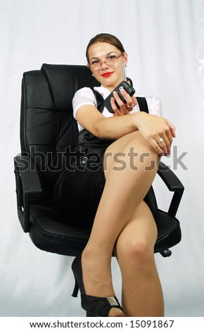 beautiful business woman posing on office chair