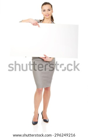 Beautiful business woman presenting empty banner. - stock photo