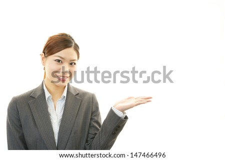 Beautiful business woman showing something with her hand