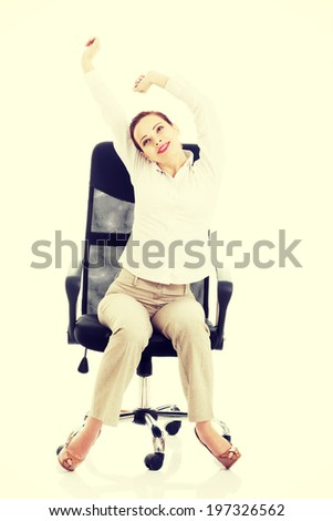 Beautiful business woman sitting and relaxing on a chair