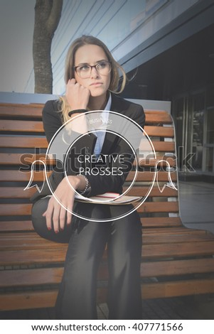Beautiful business woman sitting on a bench outside her office with creative prosses text. - stock photo