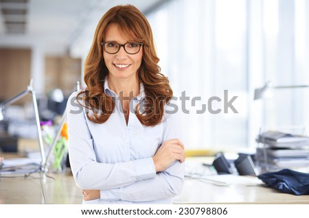 Beautiful business woman standing at office.  - stock photo