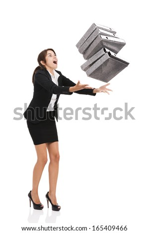Beautiful business woman stumble while carrying lots of folders on hands, isolated over white background - stock photo