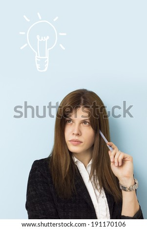 Beautiful business woman thinking seriously with light bulb above her head - stock photo