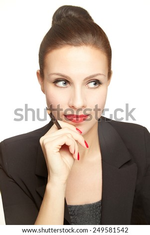 Beautiful business woman thinking with a pen in her hand. - stock photo