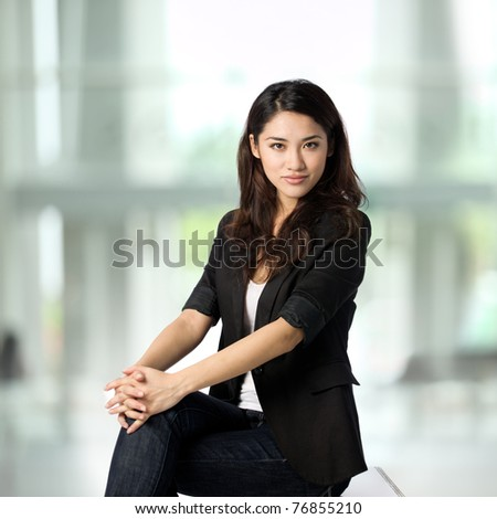 Beautiful business woman with a very relaxed, friendly smile. - stock photo