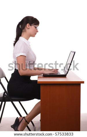 beautiful business woman with dark hair wearing glasses is sitting with a laptop