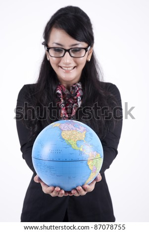 Beautiful Business Woman with Glasses holding a globe showing the map of USA