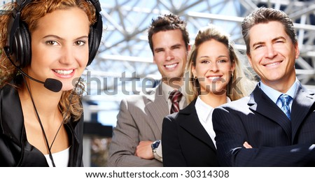 Beautiful  business woman with headset. Business people meeting