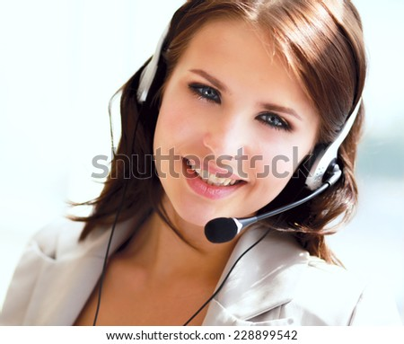 Beautiful business woman with headset. Call center. - stock photo