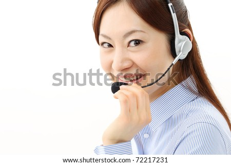 Beautiful business woman with headset. Call center. Customer support. Helpdesk. - stock photo