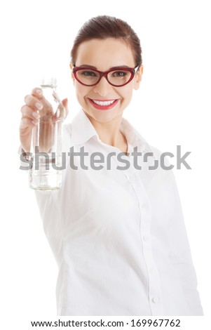 Beautiful business woman with plastic bottle of water. Isolated on white.