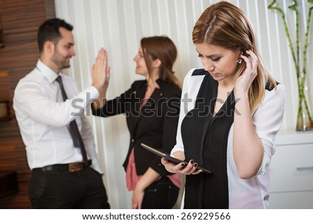 Beautiful business woman with tablet, team work, business meeting, successful idea. Business office.
