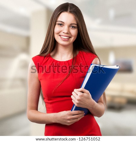 Beautiful business woman working in the office - stock photo