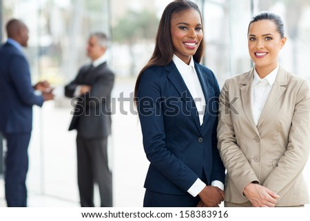 beautiful business women in modern office - stock photo