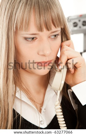 Beautiful businesswoman calling by phone and thinking - stock photo