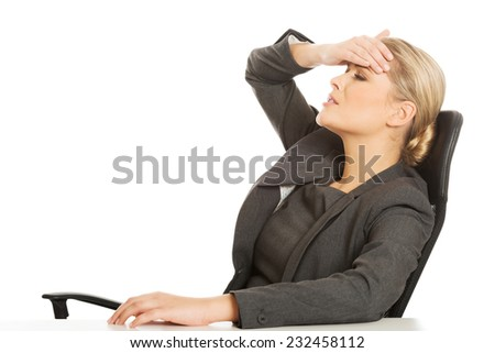 Beautiful businesswoman having huge headache - stock photo