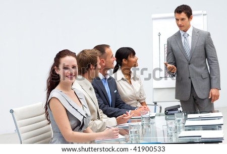 Beautiful businesswoman in a presentation listening to her colleague