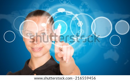 Beautiful businesswoman in dress finger presses virtual button
