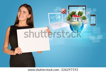 Beautiful businesswoman in dress holding paper holder. Electronics, Earth with buildings and trees in background. Elements of this image furnished by NASA - stock photo