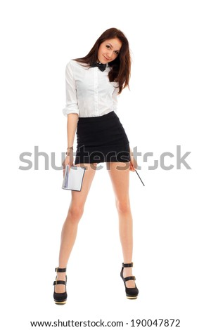 Beautiful businesswoman in short skirt with long legs with a notebook on a white background.