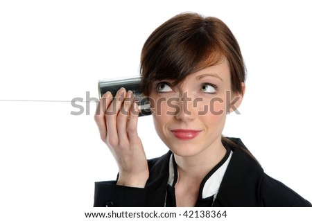 Beautiful businesswoman listening to tin can phone with string - stock photo
