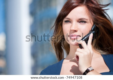 Beautiful businesswoman make call by mobile cell phone. Outdoor, over city. - stock photo