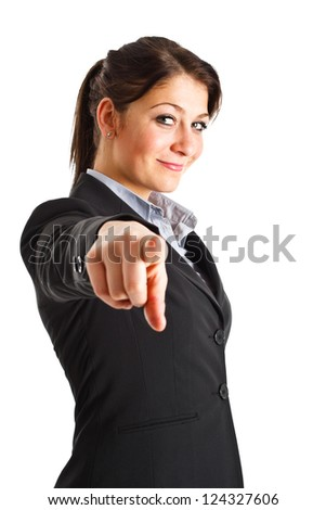 Beautiful businesswoman pointing her finger at you - stock photo