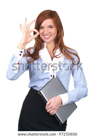 Beautiful businesswoman showing ok sign against white background - stock photo