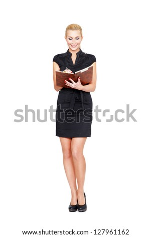 Beautiful businesswoman stands with clipboard in hands on a white isolated background - stock photo