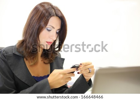 Beautiful businesswoman typing a message.