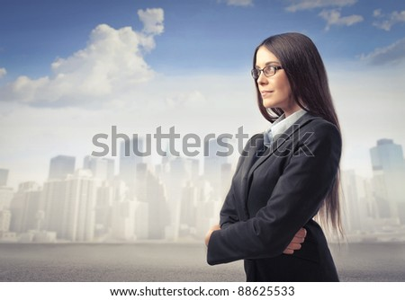 Beautiful businesswoman with cityscape in the background