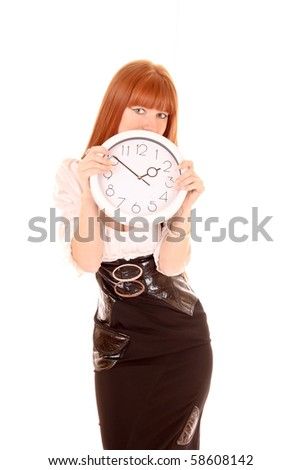 Beautiful businesswoman with clock isolated on white - stock photo