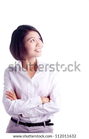 Beautiful businesswoman with hands folded looking up isolated on white background - stock photo
