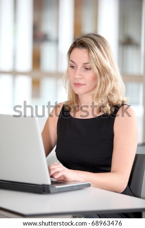 Beautiful businesswoman working on laptop computer