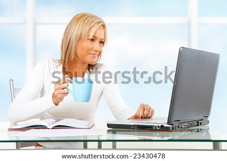 Beautiful businesswoman working or studying with laptop