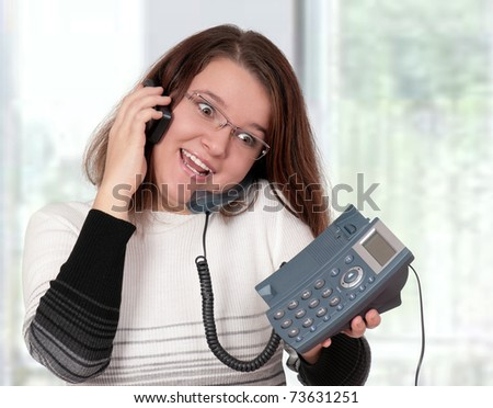 Beautiful  businesswoman working with two phone at her office - stock photo