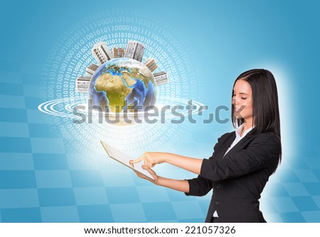 Beautiful businesswomen in suit using digital tablet. Earth with buildings. Element of this image furnished by NASA - stock photo