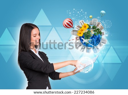 Beautiful businesswomen in suit using digital tablet. Earth with buildings, flowers, airplane and air balloons. Triangles as backdrop. Element of this image furnished by NASA - stock photo